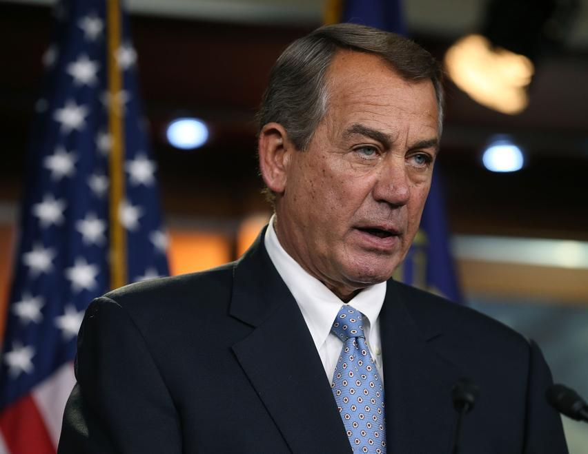 House Speaker John Boehner speaks to the media during his weekly news conference on Capitol Hill June 18.